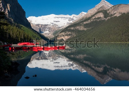 Lake Louise and Red Canoes with mountain reflection