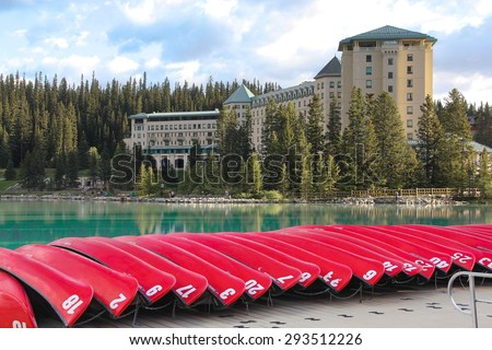 LAKE LOUISE, CANADA - JUNE, 8: Hotel Chateau Lake Louise in Alberta, Canada, with red canoes in the foreground on 08, June, 2015.  - stock photo