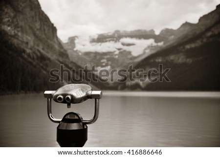 Lake Louise with binocular in Banff national park with mountains and forest in Canada. - stock photo