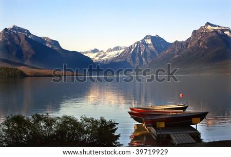 Lake McDonald Boats Snow Mountains at Glacier National Park - stock photo