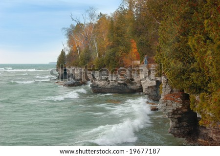 Lake Michigan cliffs along the shore in autumn. - stock photo