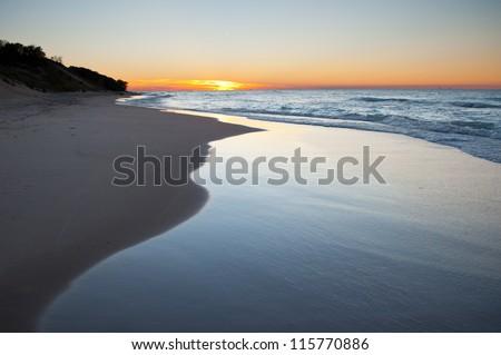Lake Michigan sunset waves - stock photo