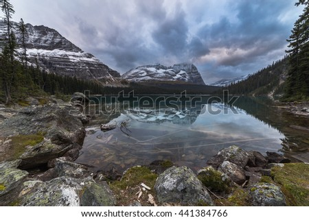 Lake O'Hara on a cloudy day around sunset time. Lake O'Hara is located in Yoho National Park inside the Canadian Rockies in British Columbia Province in Canada - stock photo