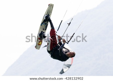 Lake Of Santa Croce, Italy - May 21, 2016: Professional  Kitesurfer jumps over the water during training on Lake of Santa Croce
