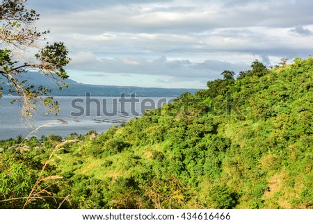 lake on the hill with a volcano in green rainforest Philippine - stock photo