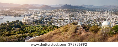 Lake Pichola with City Palace panoramic view from the hill in Udaipur, Rajasthan, India - stock photo