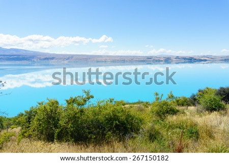 Lake Pukaki, shimmering turquoise snow feed water and scenic jewel in the Mackenzie Basin, South Island New Zealand. - stock photo