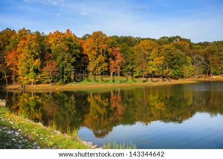 Lake reflection with fall color - stock photo