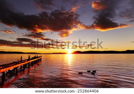 Lake Rotorua at sunrise, North Island, New Zealand - stock photo