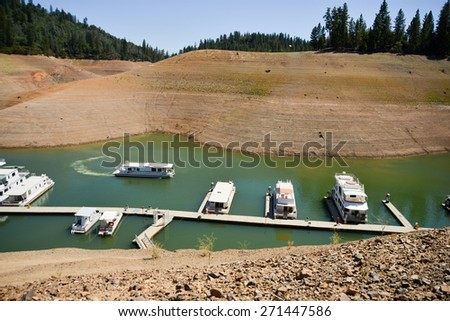 Lake Shasta, CA, August 20, 2014 -- California's lingering drought exposes the 180-200 foot drop in water levels. The state's largest reservoir is receding at an average of 4.9 inches per day.