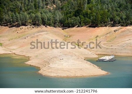 Lake Shasta, California, August 17, 2014 -- California's lingering drought exposes the 180-200 foot drop in water levels. The reservoir is receding at an average of 4.9 inches per day.