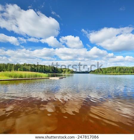 Lake shore and a beautiful cloudscape. Latvia - stock photo