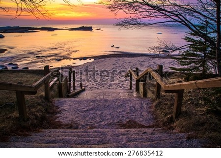 Lake Superior Sunset. Stairs leading to a beautiful Lake Superior sunset beach at the Hurricane River Campground in Pictured Rocks National Lakeshore. - stock photo