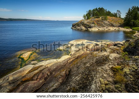 lake surface in the stony shores - stock photo