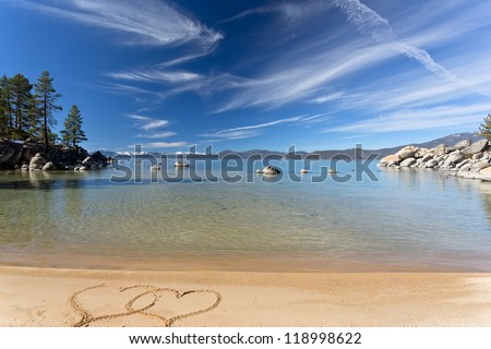 Lake Tahoe beach with two hearts - stock photo