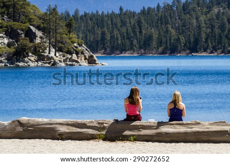 Lake Tahoe, California - April 29 : Two female friends enjoying a back after a long hike down to Emerald Bay, April 29 2015 Lake Tahoe, California. - stock photo