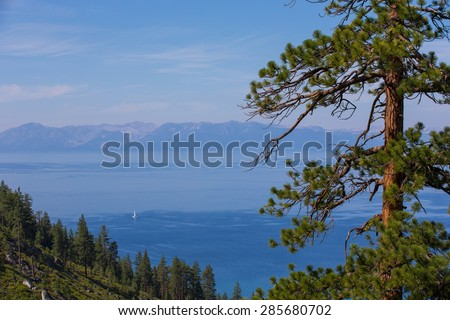 Lake Tahoe Morning Light - View of Lake Tahoe and the Tahoe Rim from Tunnel Creek.  Copy space in the upper left side of frame. - stock photo