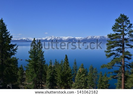 Lake Tahoe National park jointly in the states of California and Nevada, the time is early spring in May 2013. It is a freshwater lake in the Sierra Nevada. It has a surface elevation of 6,225 ft. - stock photo