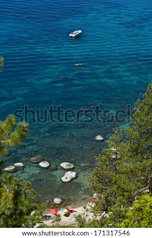 Lake Tahoe Summer Time, California, United States. Crystal Clear Water of the Lake Tahoe with People Having Fun.