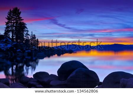 Lake Tahoe Sunset with granite boulders/Tahoe Sunset/Large granite boulders in Lake Tahoe at Sand Harbor, Nevada - stock photo