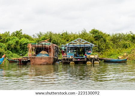 LAKE TONLE SAP, COMBODIA - SEP 28, 2014: Nature and houses of the Chong Knies Village on the Tonle Sap Lake, the largest freshwater lake in Southeast Asia, a UNESCO biosphere since 1997