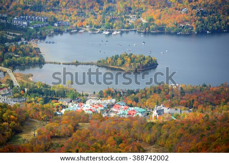Lake Tremblant and Mont-Tremblant village in fall with fall foliage, from top of Mont Tremblant, Quebec, Canada. - stock photo
