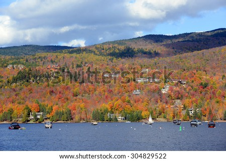 Lake Tremblant and Mont-Tremblant village in fall with fall foliage, Town of Mont-Tremblant, Quebec, Canada. - stock photo