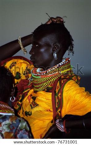 LAKE TURKANA, KENYA - DECEMBER 26: A Turkana girl in traditional clothes, 26 December 2004 at Lake Turkana, Kenya. The Turkanas is a pastoralist tribe living in Northern Kenya in small villages. - stock photo