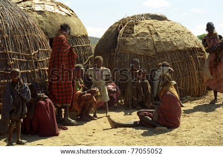 LAKE TURKANA, KENYA - DECEMBER 28: Turkana people in the village, December 28, 2004 at Lake Turkana, Kenya. The Turkanas live in huts in Northern Kenya inharsh conditions. They are nomadic. - stock photo