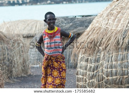 LAKE TURKANA, KENYA-JANUARY 12: Unidentified El molo woman  near lake Turkana on January 12, 2013 , Kenya. The El molo are one of the disappearing tribes of Africa.  - stock photo