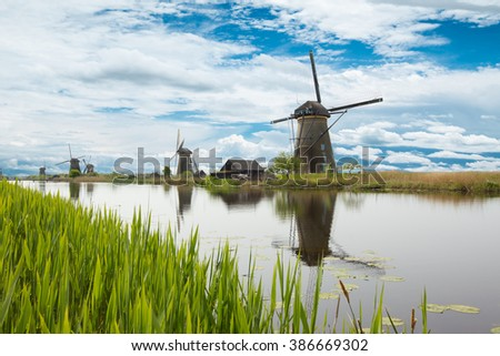 Lake vegetation with traditional wind mills. Holland - stock photo