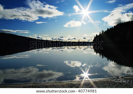 Lake view with sun reflection and silhouette