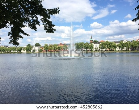 Lake view with the fountain and rainbow in Schwerin Germany - stock photo
