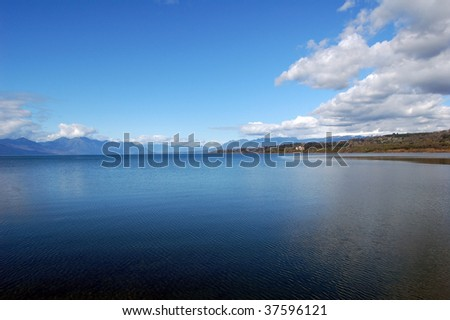 Lake Villarrica, is located southeast of the Province of Cautin, east lies the city of Pucon, west lies the town of Villarrica, south the Villarrica Volcano, one of the ten most active in the world. - stock photo