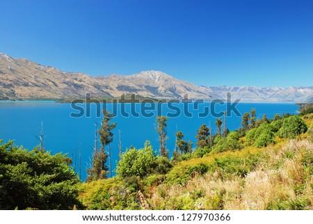 Lake Wakatipu - inland lake in the South Island of New Zealand. - stock photo