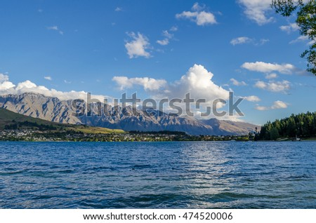 Lake Wakatipu view with Remarkables Mountain Range in afternoon light