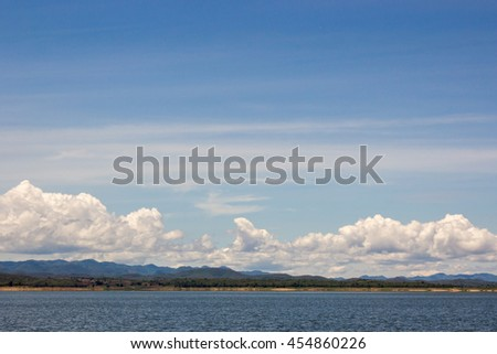 lake water and mountain with blue sky