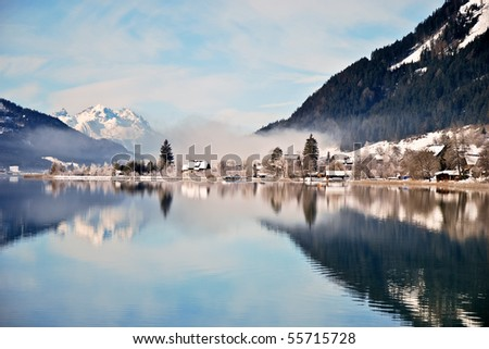Lake Weissensee in Austrian Alps in winter with scenic reflection - stock photo