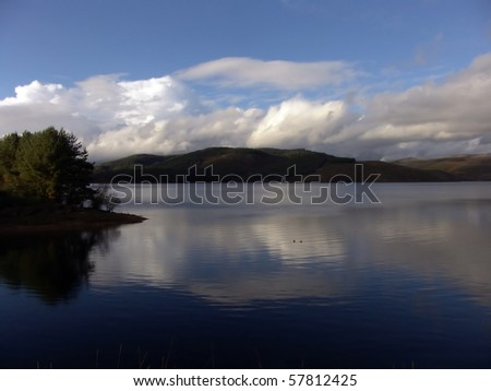 Lake with blue sky - stock photo