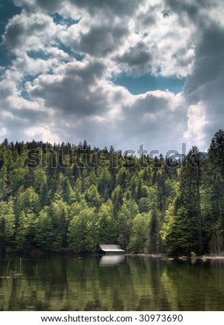 lake with boathouse, HDR Image - stock photo