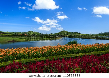 Lake with Colorful Garden And Blue Sky - stock photo