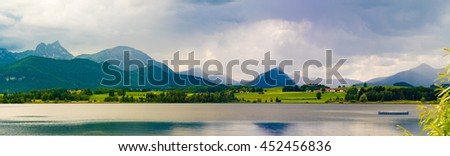 lake with lilies and mountains reflected in the water