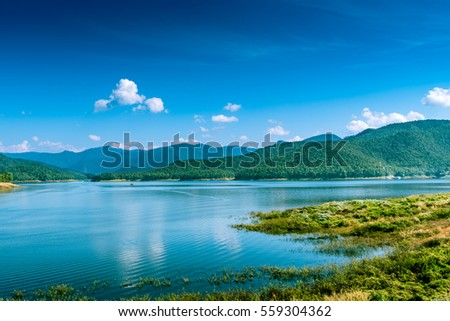 Lake with mountain on blue sky background