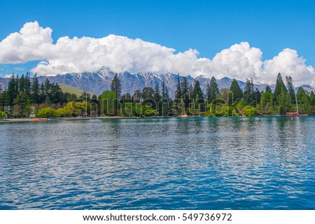 lake with snow mountains background