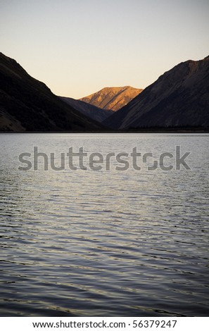 Lake with sunset-lit mountain in New Zealand