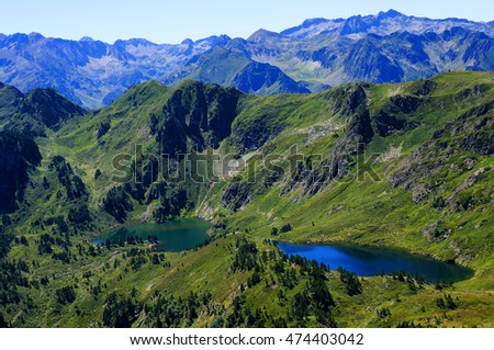 Lakes in a valley in the mountains on a sunny day in the Pyrenees, France