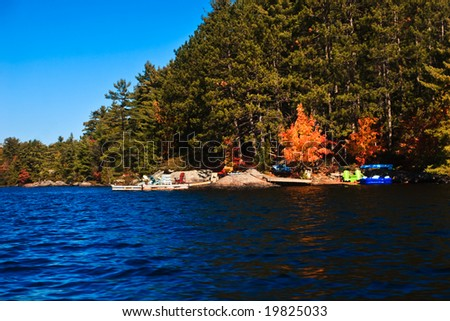 Lakeside cottages during the fall season - stock photo