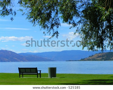 Lakeside Park Bench - stock photo