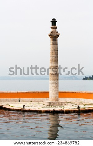 Lakeside Pier and Lighthouse, Lake Garda, Italy - stock photo