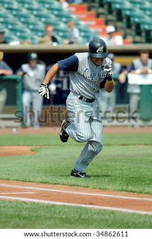 LAKEWOOD, NJ - AUGUST 5: Lake County Captains infielder Mark Thompson digs for first base during the August 5, 2009 game in Lakewood, NJ.